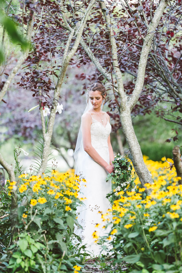 Portrait of bride in a flower garden.