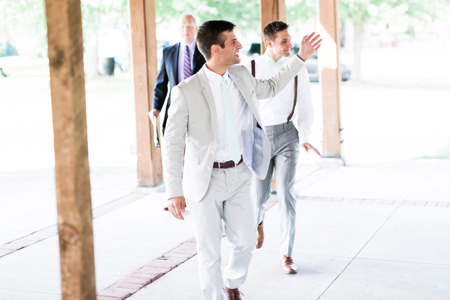 Groom walks into his wedding ceremony.