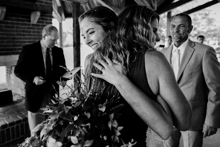 Bride hugs her mom and her wedding ceremony.