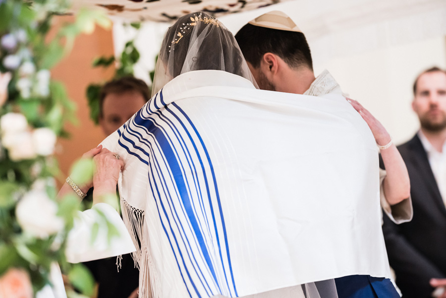 Bride and groom at Jewish wedding ceremony.