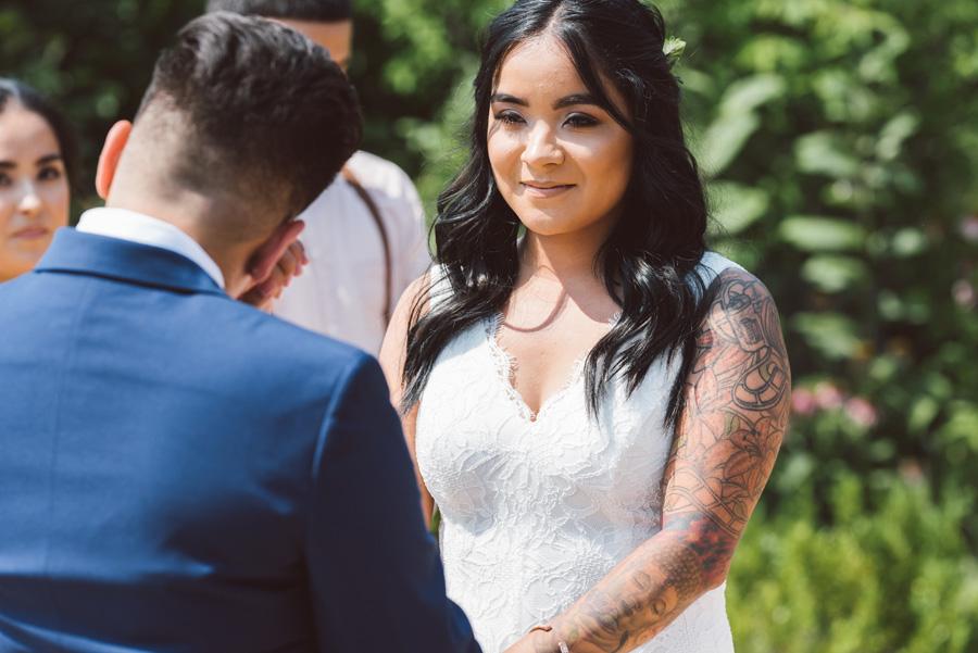 Brides exchange vows at wedding.