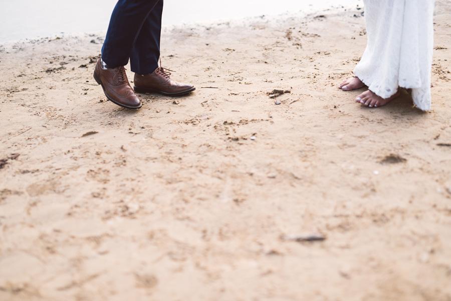 Brides feet on beach at Lake Katherine.