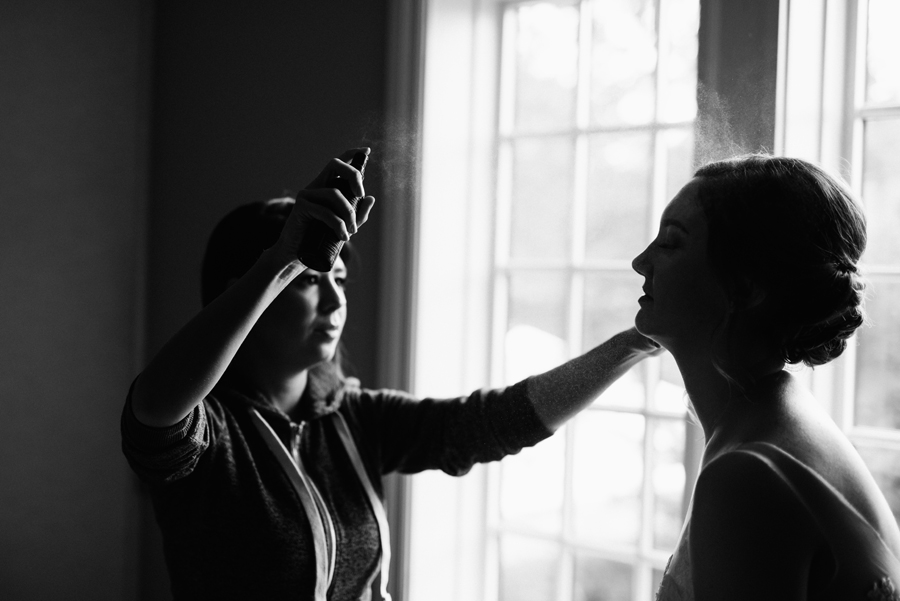 Bride getting hairsprayed.