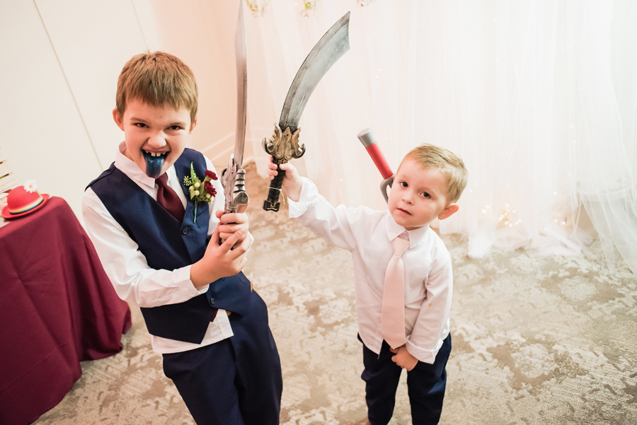 Ringbearers have fun at reception.