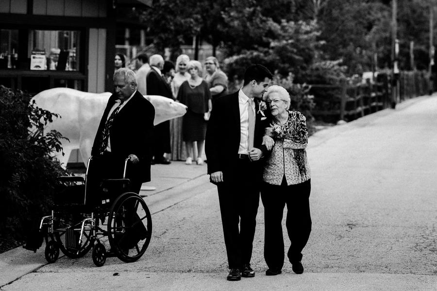 Groom walks his grandma down the aisle.