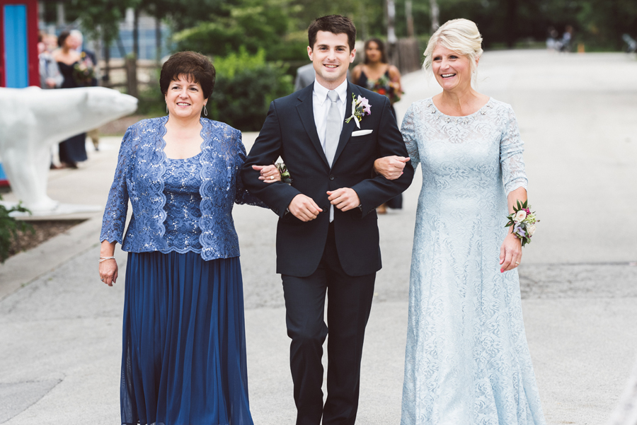 Groom walks the moms down the aisle.
