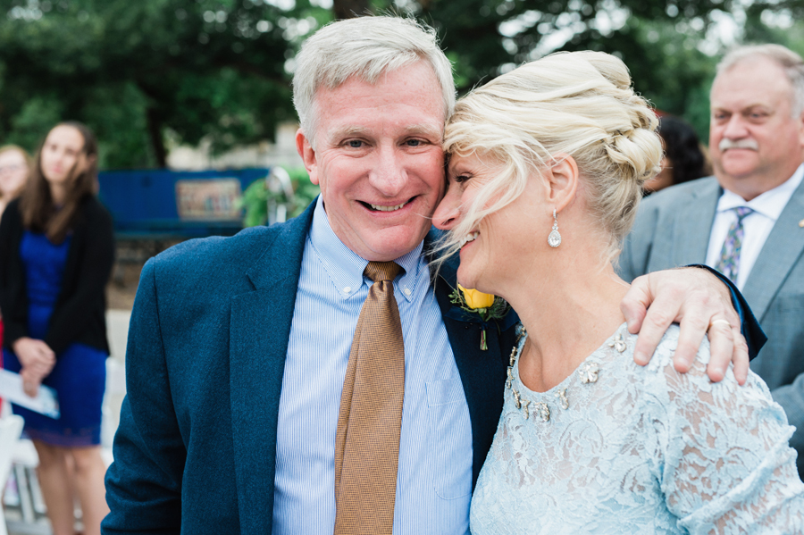 Mom and dad react during wedding ceremony.