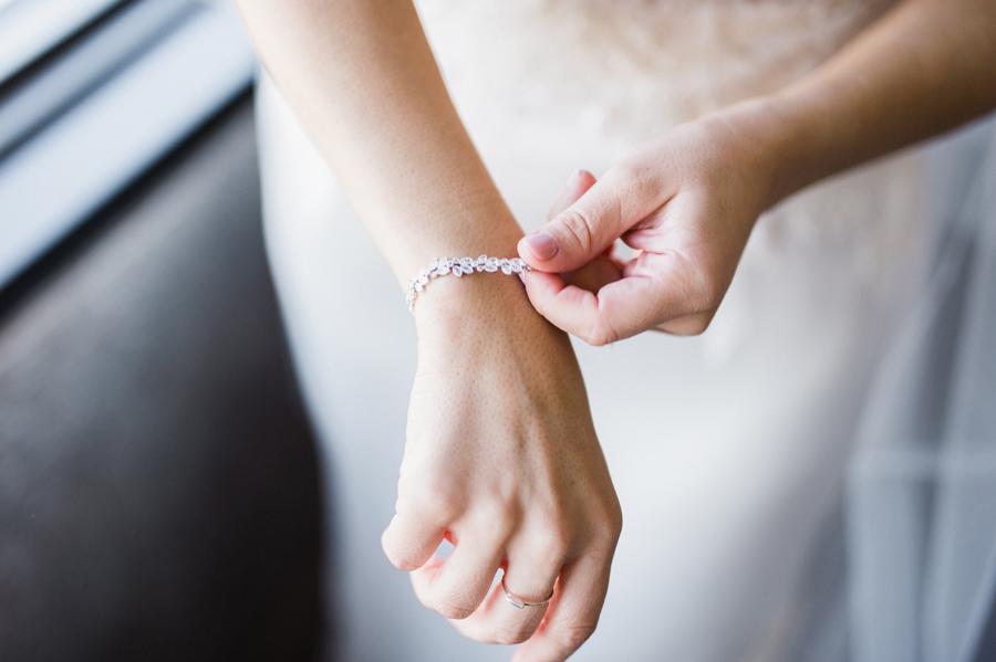 Bride puts on her bracelet.