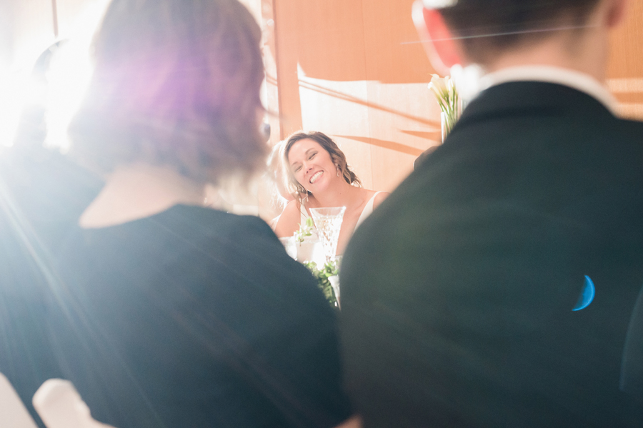 Bride reacts to speeches.