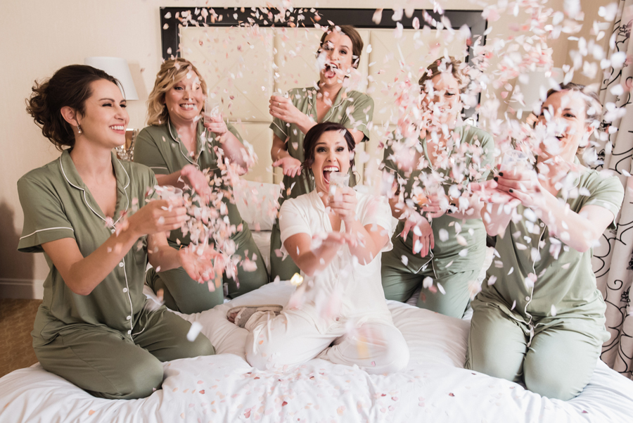 Bride and bridesmaids with confetti.