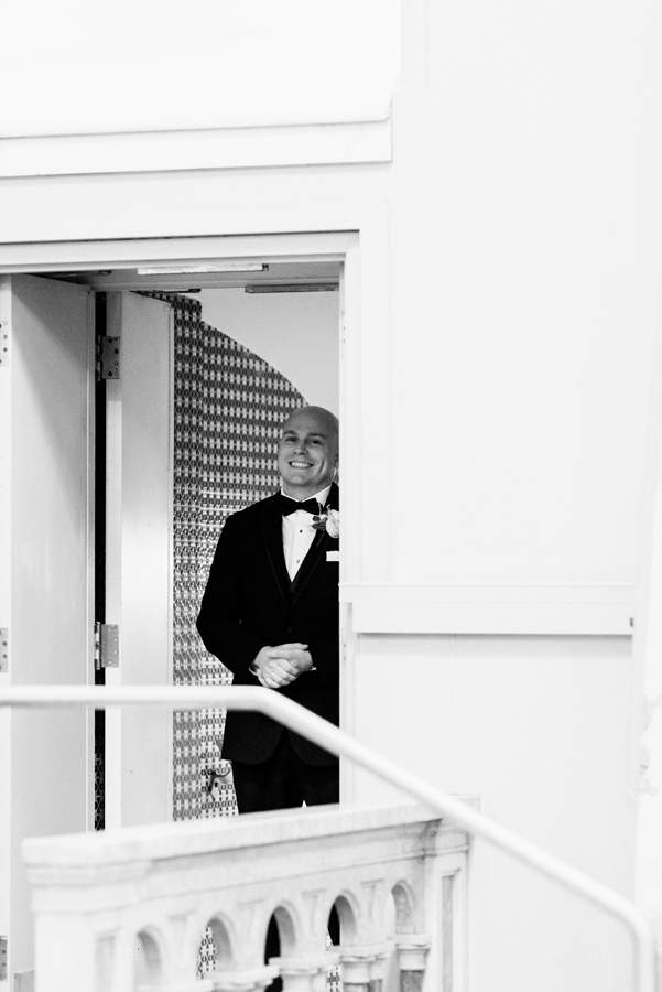 Groom waiting to walk into ceremony.