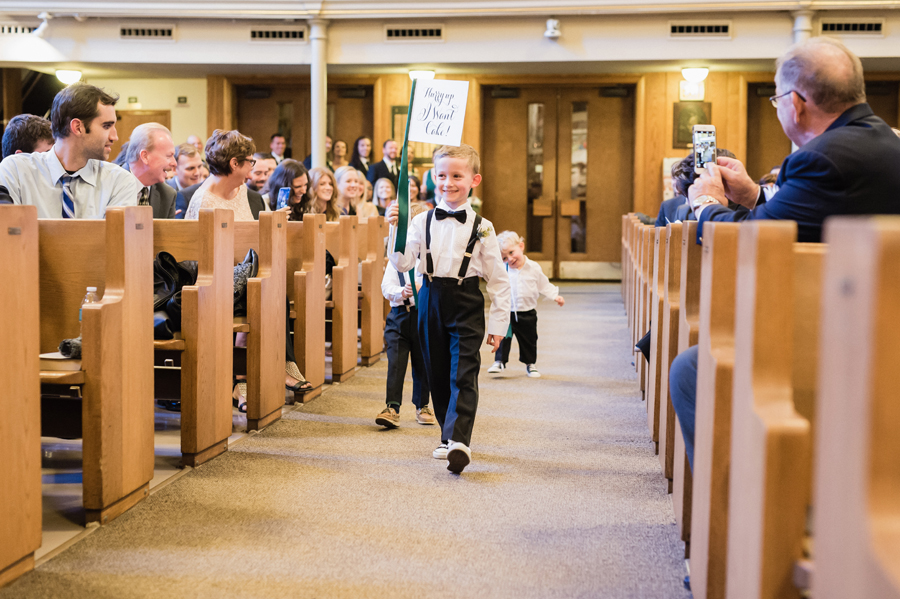 Ringbearers walk down the aisle.