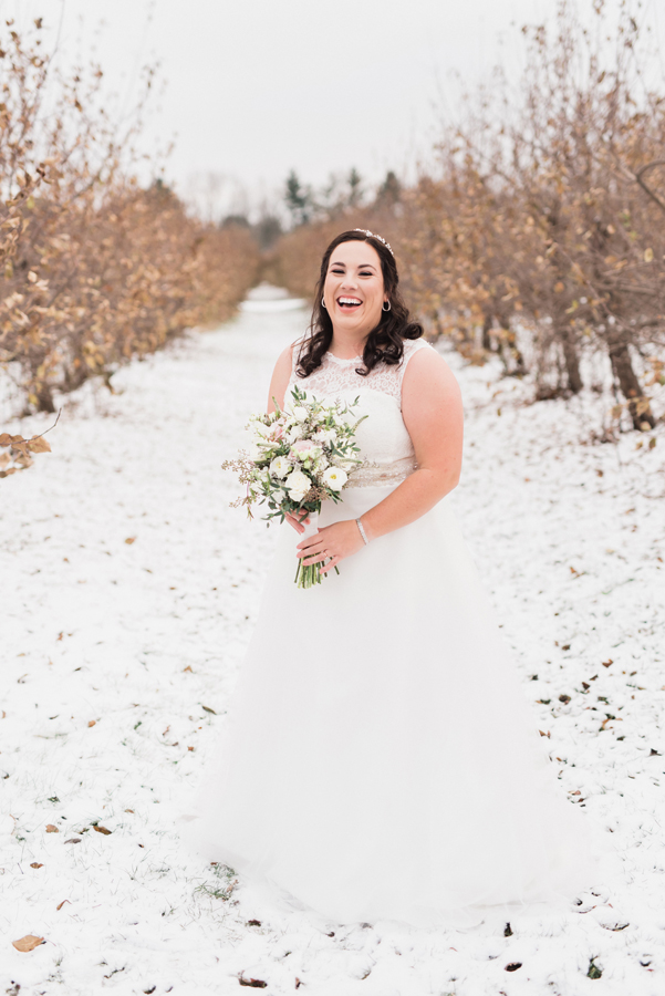 Portrait of bride in orchard.