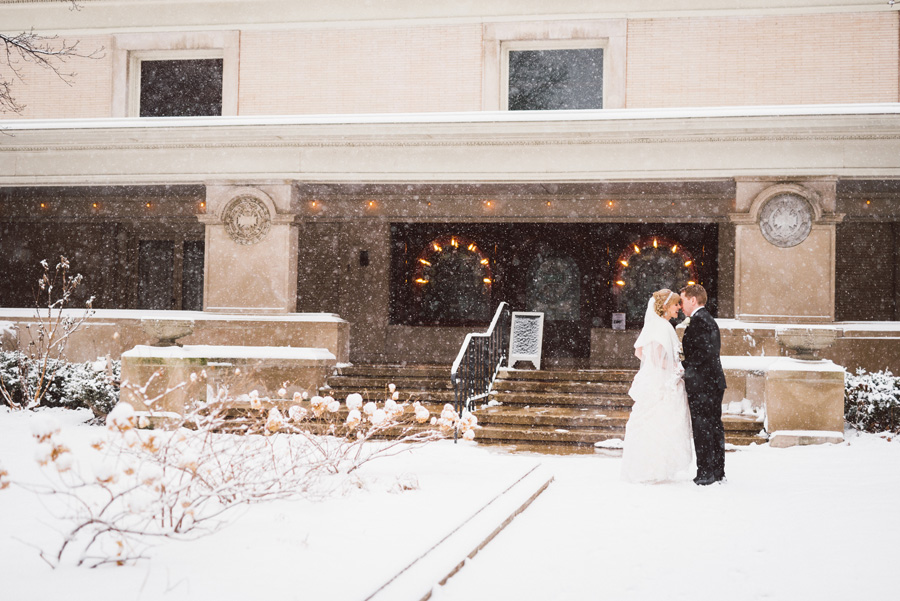 Bride and groom on a snowy day.