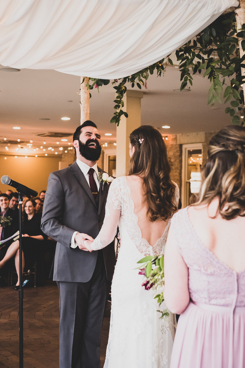 Groom reacts during wedding ceremony.