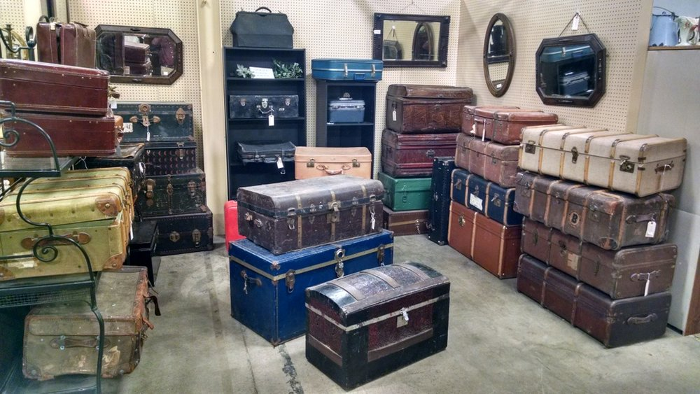 We have lots of trunks and vintage suitcases - Find us on aisle E