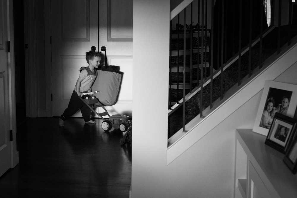 toddler mowing lawn indoors.jpg