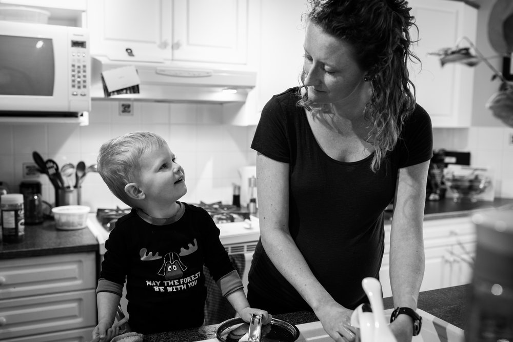 mom and son wash dishes
