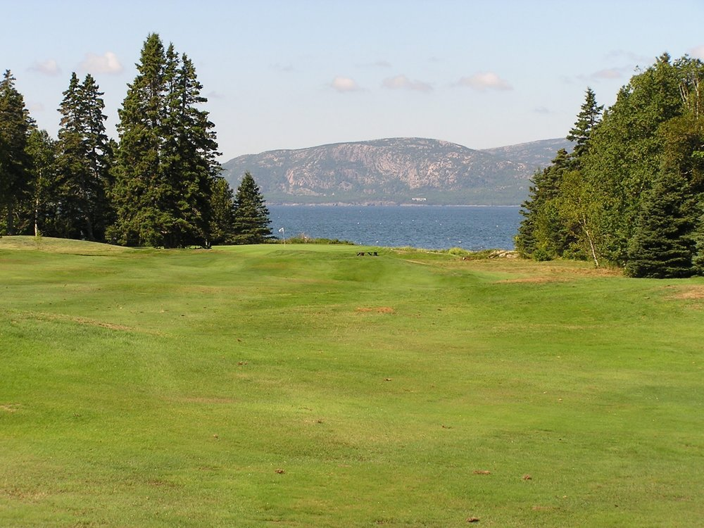#3 Halibut Hole - Par 4Next up is a 317 yard dogleg left.  A 200 yard shot up the hill leaves a short approach down the other side.  As you reach the top of the hill a spectacular view of Frenchman Bay awaits.