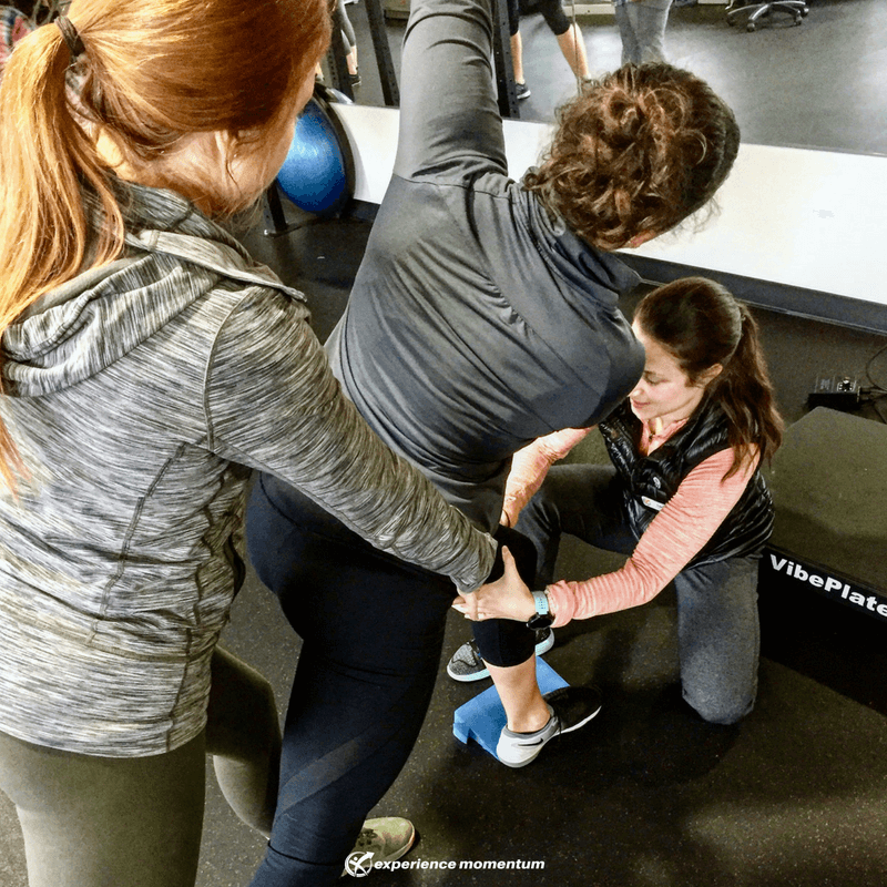 Dr. Laura Mizumoto and fellow Physical Therapist, Dr. Taylor Carney facilitating effective loading through the left leg of a CrossFit Athlete.
