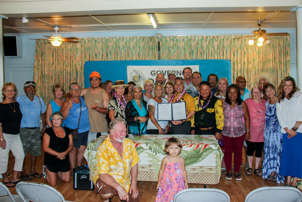 Gov. David Ige signed into law SB 2293 that provides funding for a process to help keep units in Front Street apartments affordable.  (July 7, 2018)