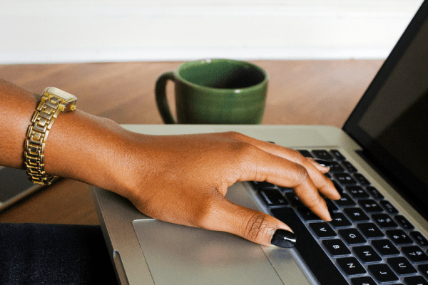 black-woman-hand-on-laptop-createherstock.png