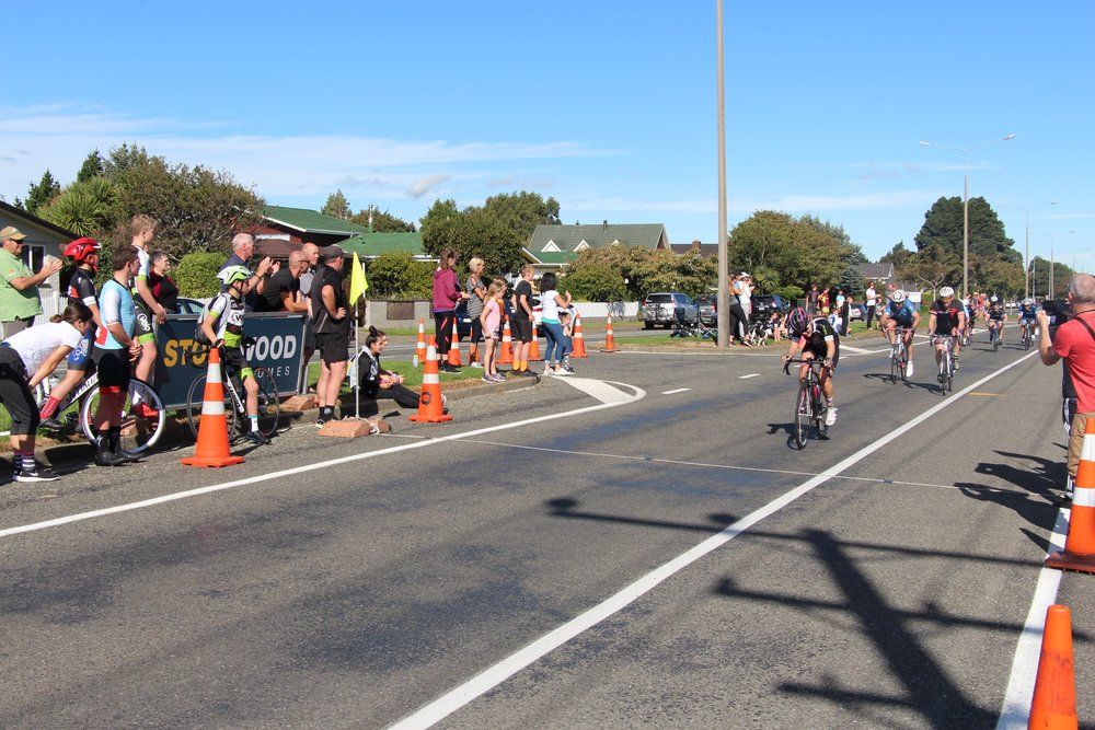 KateWilson crosses the finish line at Racecourse Rd. Photo: Cycling Southland
