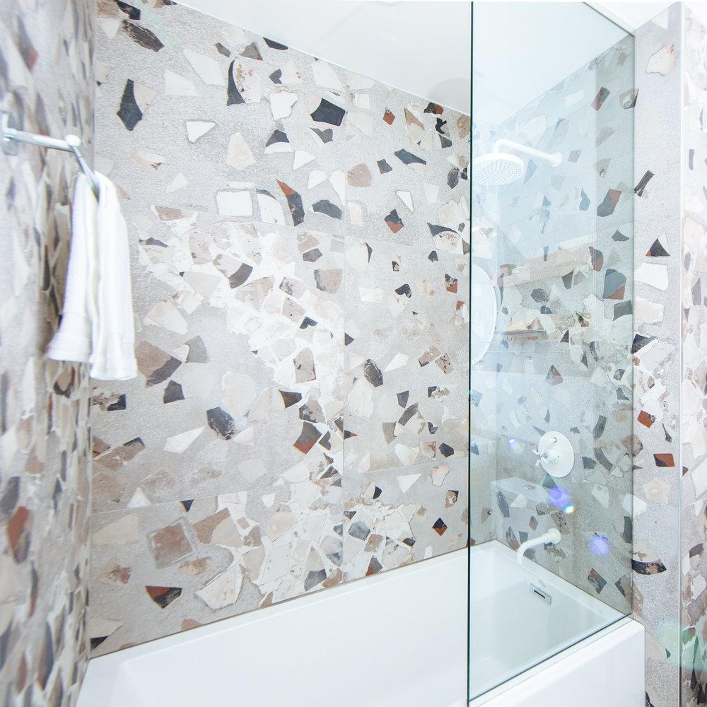 Terrazzo shower white fixtures futuristic interior design