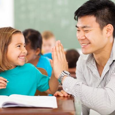 2017-02-28-Teacher-High-Fiving-Student-condensed-2.jpg