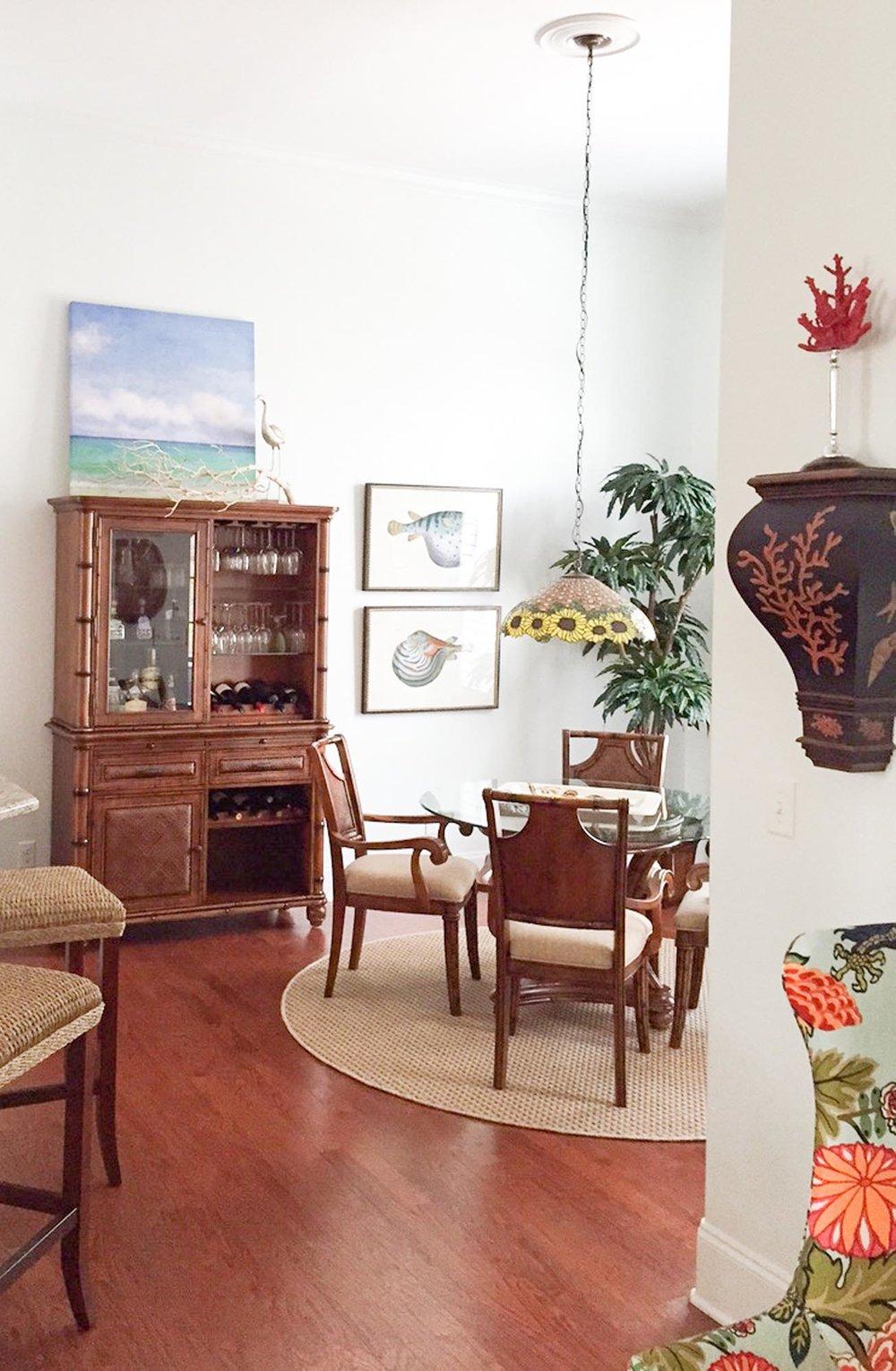 Breakfast room with coastal inspired art
