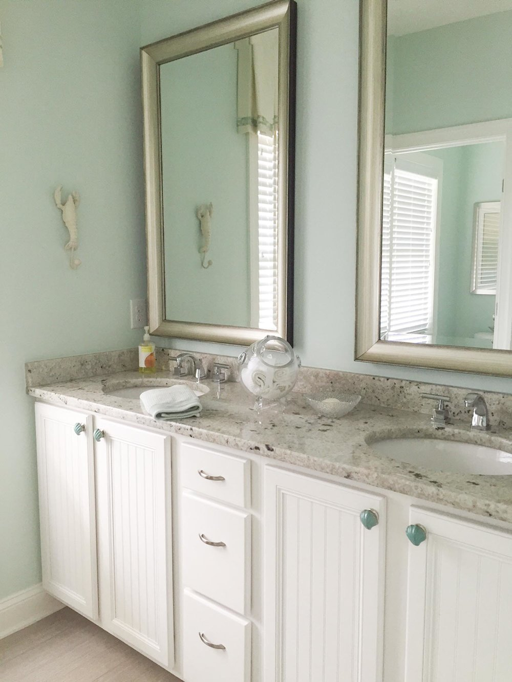 Master bathroom vanity with granite countertops