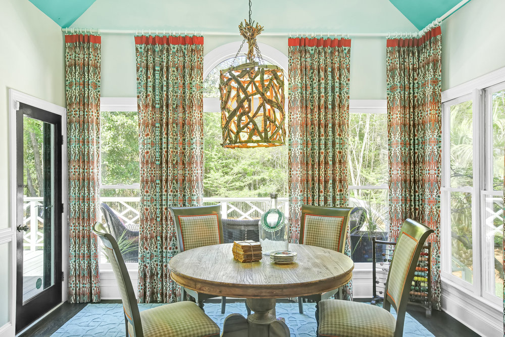 Bright breakfast room with patterned ikat window coverings