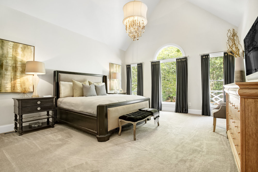 Master bedroom with ornate shell chandelier