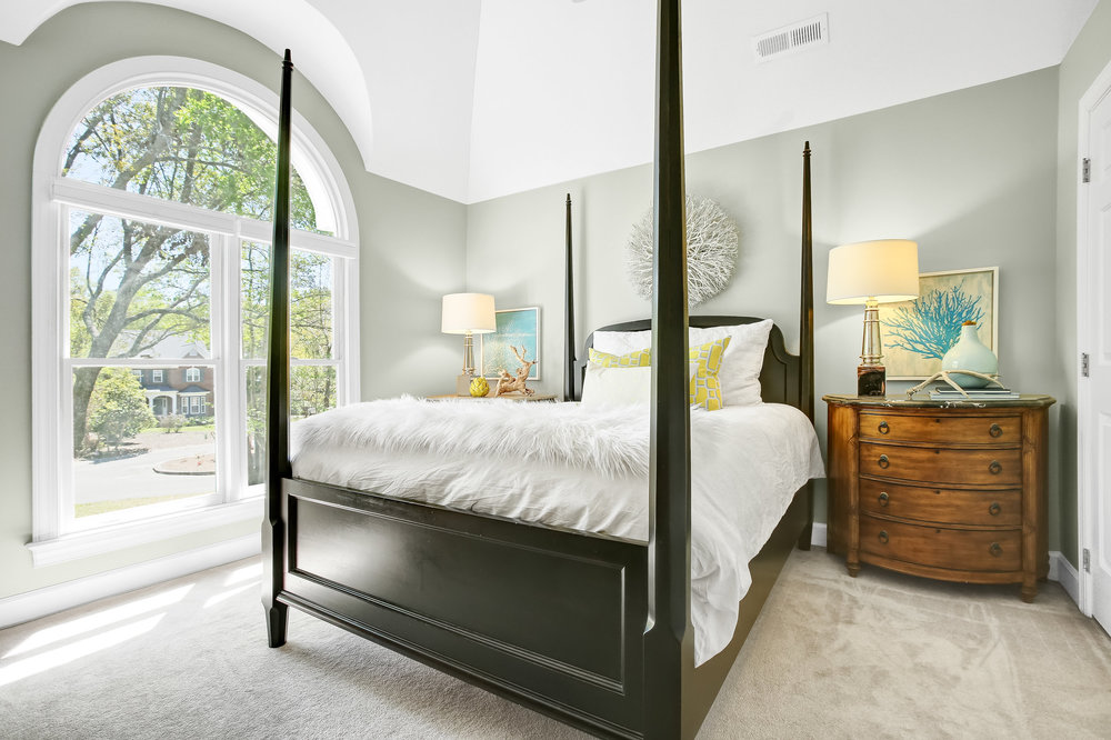 Bedroom with wood poster bed
