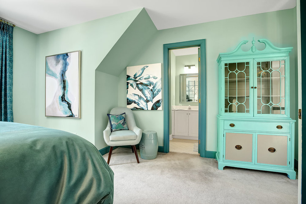 Aqua colored bedroom with repainted hutch