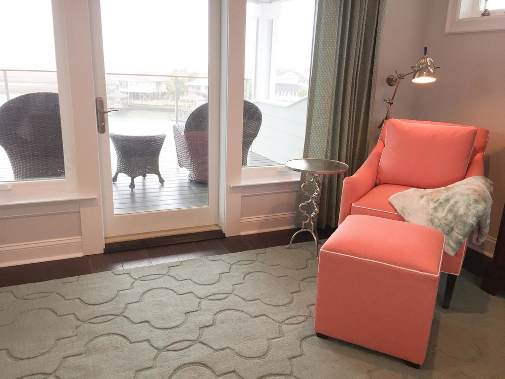 Master bedroom sitting area with coral easy chair and ottoman