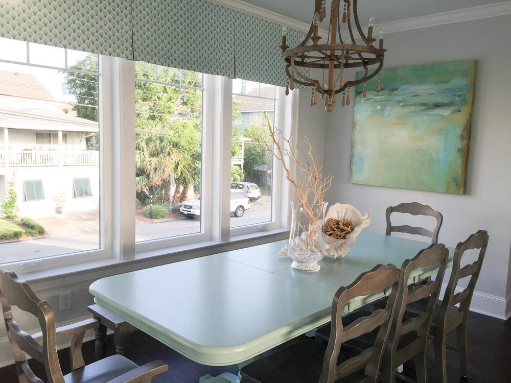 Dining area with blue table and wooden bench