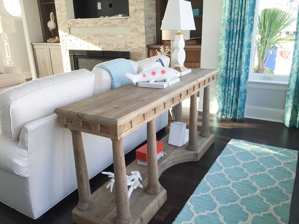 Wooden console with costal themed accessories
