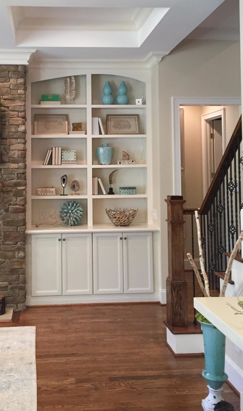 Bookcase with a mix of blue and beige accessories