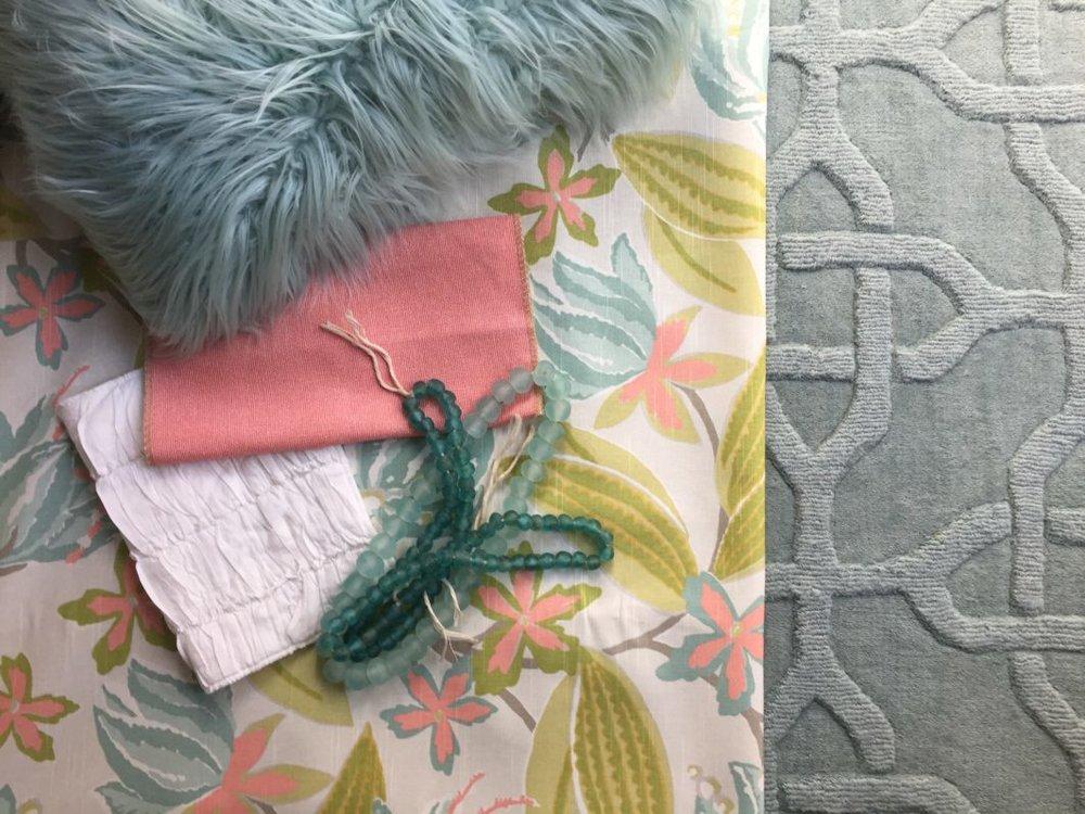 Floral fabric overlaid on grey carpet