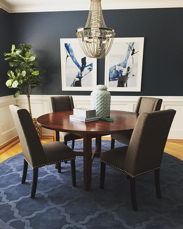 There is no way you could have the #mondayblues in this dining room we completed over the weekend! . . . .  #fromwhereistand #interiordesign #interiorstyle  #designlovers #designinspiration #interiors #instadesign #instastyle #homedecor #homedesign #maritimeinteriordesign #decorating #inspiration #thisishowwedoit #wilmington #northcarolina #interiordesigner #interiordesignerslife #diningroom #fiddleleaffig #upholstery #customfurniture #abstractart #navy #art #rug #homedesign