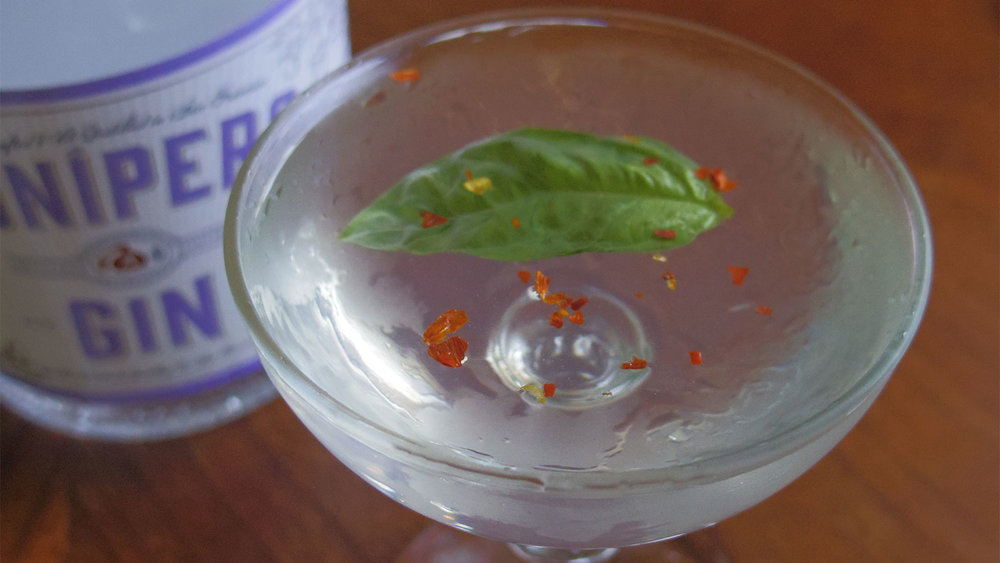 My basil and red chile flake gin martini is a simple twist with sweet, herbal, and spicy tones.