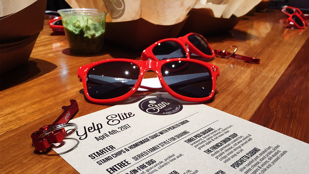 We were greeted with menus, sunglasses, and keychains upon arrival at The Stand.