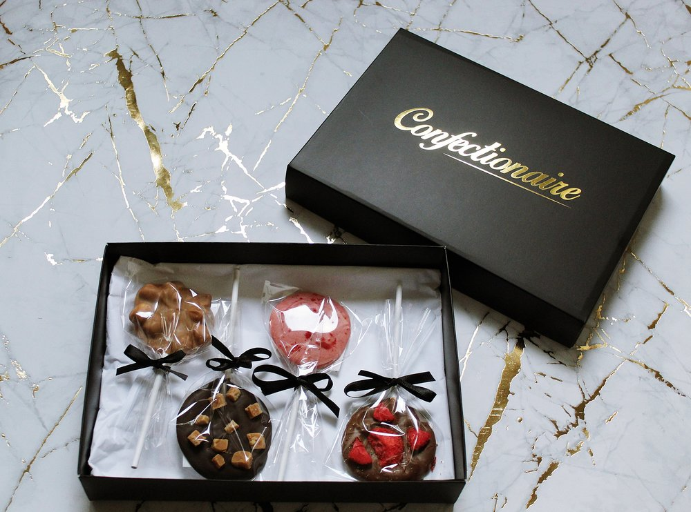 Our fabulous lolly collections are sure to put a smile on your guests faces so why not choose the flavours you think your guests will enjoy? Simply choose whether you would prefer a gold or black A5 box, complete with luxury black satin bow for an elegant finishing touch.