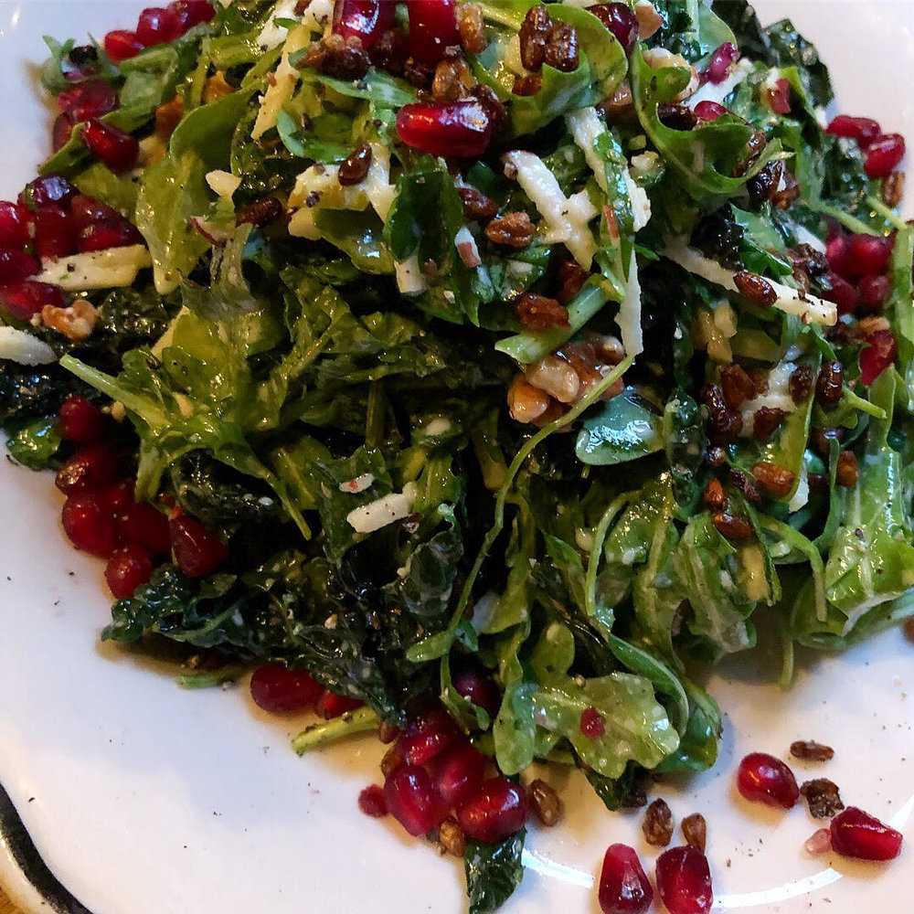 Kale apple salad: roasted kale, goat cheese vin, seasonal fruit, walnuts, crispy freekeh