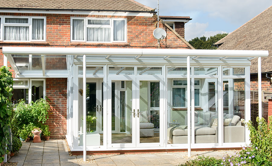 Garden room veranda in white uPVC French doors Cave ADJ02.jpg
