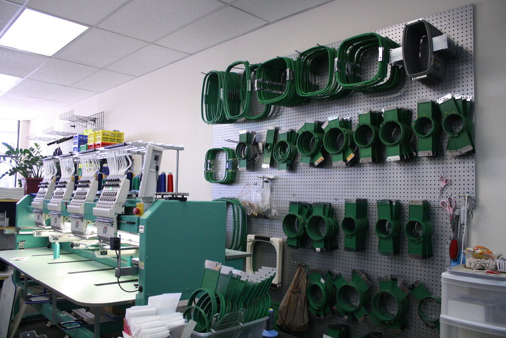 A view of one of four Tajima machines, and hoops capable of sewing virtually any size design.