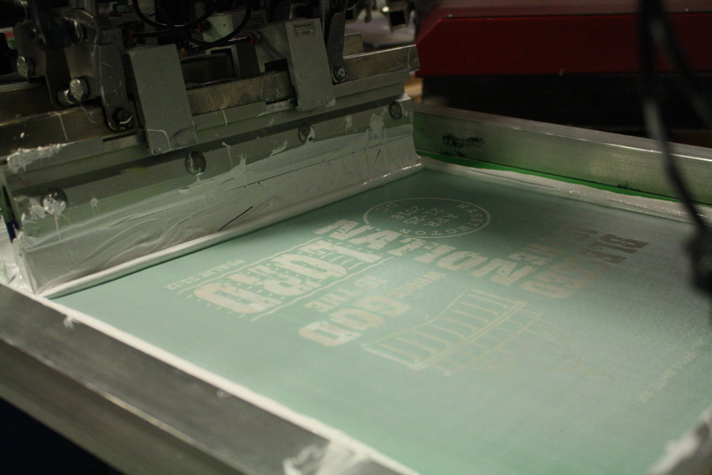Following a pass through our automatic screen print press.
