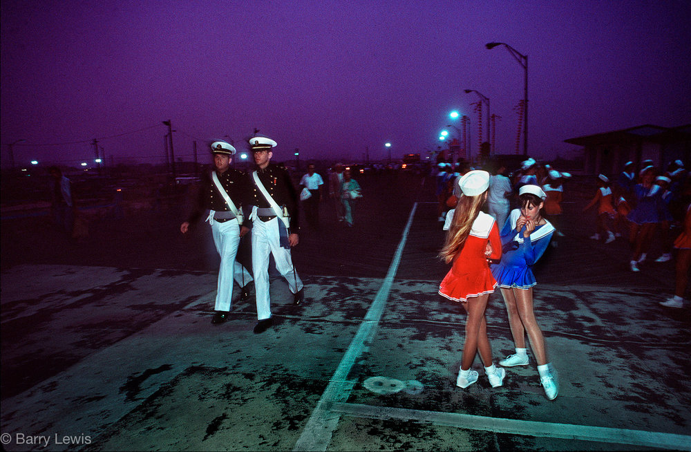 Soldiers and sailors gather on the Boardwalk after the Miss America parade, Atlantic City, USA, 1984