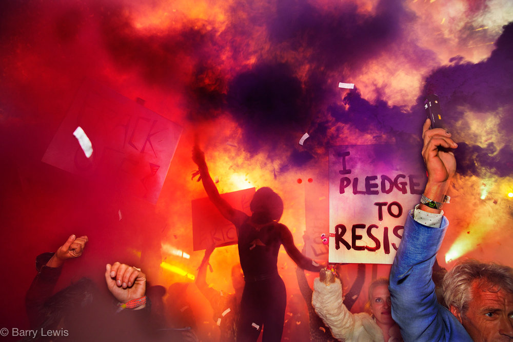 Glastonbury Festival, 2015. Public demonstration storming the Hell stage in Shangri La.